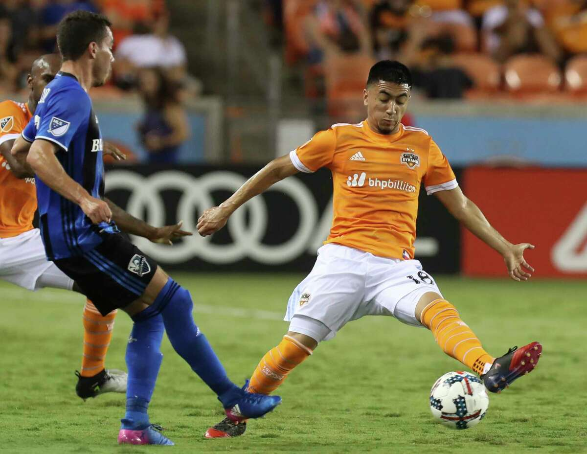 Houston Dynamo midfielder Memo Rodriguez (18) tries to intercept a pass from Montreal Impact midfielder Daniel Lovitz (3) during the second half of the game at BBVA Compass Stadium Wednesday, July 5, 2017, in Houston. Houston Dynamo defeated Montreal Impact 3-1.
