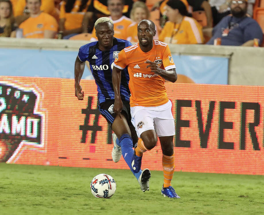 Houston Dynamo defender DaMarcus Beasley (7) looks up for a pass while Montreal Impact forward Ballou Jean-Yves Tabla (13) is trying to stop him during the second half of the game at BBVA Compass Stadium Wednesday, July 5, 2017, in Houston. Houston Dynamo defeated Montreal Impact 3-1. Photo: Yi-Chin Lee, Houston Chronicle / © 2017  Houston Chronicle