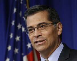 FILE -- In this May 3, 2017 file photo, California Attorney Gen. Xavier Becerra speaks in Sacramento, Calif. California's attorney general says the number of hate crimes increased about 11 percent last year, the second consecutive double-digit increase after years of decline. The report released Monday, July 3, 2017 shows 931 hate crimes statewide in 2016, nearly 100 more than in 2015. (AP Photo/Rich Pedroncelli, file)