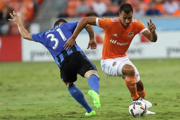 Houston Dynamo midfielder Juan David Cabezas (5) battles with Montreal Impact midfielder Blerim Dzemaili (31) during the first half of the game at BBVA Compass Stadium Wednesday, July 5, 2017, in Houston. ( Yi-Chin Lee / Houston Chronicle )