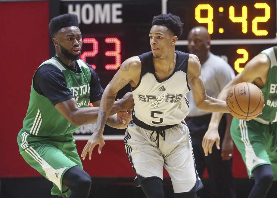 San Antonio Spurs guard Dejounte Murray (5) drives as Boston Celtics forward Jaylen Brown, left, defends during the first half of an NBA summer league basketball game Wednesday, July 5, 2017, in Salt Lake City. (AP Photo/Rick Bowmer) Photo: Rick Bowmer/AP