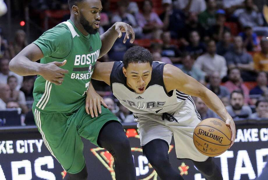 San Antonio Spurs guard Bryn Forbes, right, drives against Boston Celtics forward Jaylen Brown, left, during the second half of an NBA summer league basketball game Wednesday, July 5, 2017, in Salt Lake City. (AP Photo/Rick Bowmer) Photo: Rick Bowmer/AP