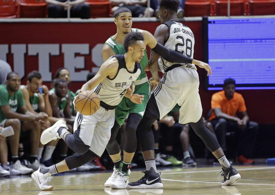 San Antonio Spurs guard Derrick White (4) drives around Boston Celtics forward Jayson Tatum, center, during the first half of an NBA summer league basketball game Wednesday, July 5, 2017, in Salt Lake City. (AP Photo/Rick Bowmer) Photo: Rick Bowmer/AP