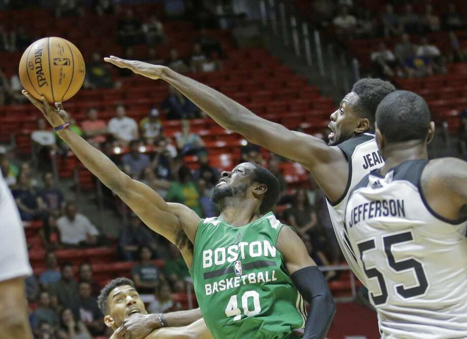 Boston Celtics guard Scoochie Smith (40) lays the ball up as San Antonio Spurs forward Livio Jean-Charles, right rear, and  forward Cory Jefferson (55) defend during the first half of an NBA summer league basketball game Wednesday, July 5, 2017, in Salt Lake City. (AP Photo/Rick Bowmer) Photo: Rick Bowmer/AP