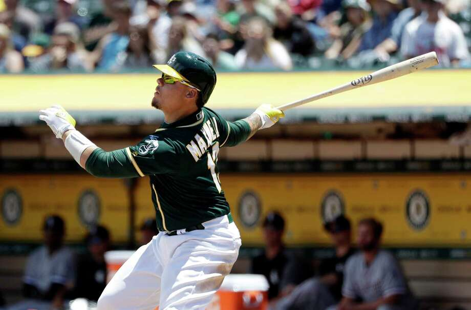 Oakland Athletics' Bruce Maxwell drives in two runs with a double against the Chicago White Sox during the third inning of a baseball game Wednesday, July 5, 2017, in Oakland, Calif. (AP Photo/Marcio Jose Sanchez) ORG XMIT: OAS107 Photo: Marcio Jose Sanchez / Copyright 2017 The Associated Press. All rights reserved.