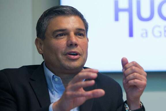 New Baker Hughes a GE company CEO Lorenzo Simonelli speaks during a meeting at the company's office in north Houston, Wednesday, July 5, 2017.