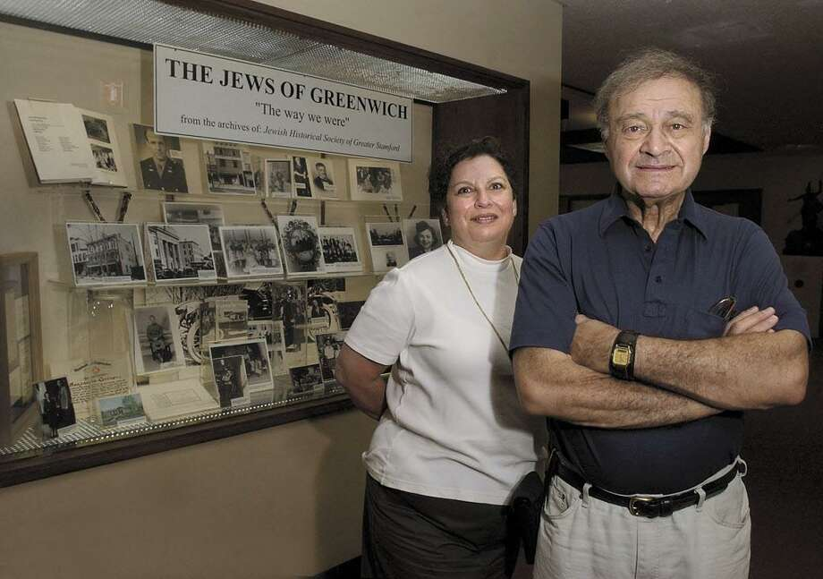 """8-15-2002, GREENWICH TOWN HALL, Irwin Miller, Historian for the Jewish Historical Society of Greater Stamford, right, and Linda Baulsir, a member of the Board of Directors for the same organization, posed next to  """"The Jews of Greenwich"""" display at Greenwich Town Hall...........PHOTO/LUCKEY JR...COLOR.... Photo: GT"""