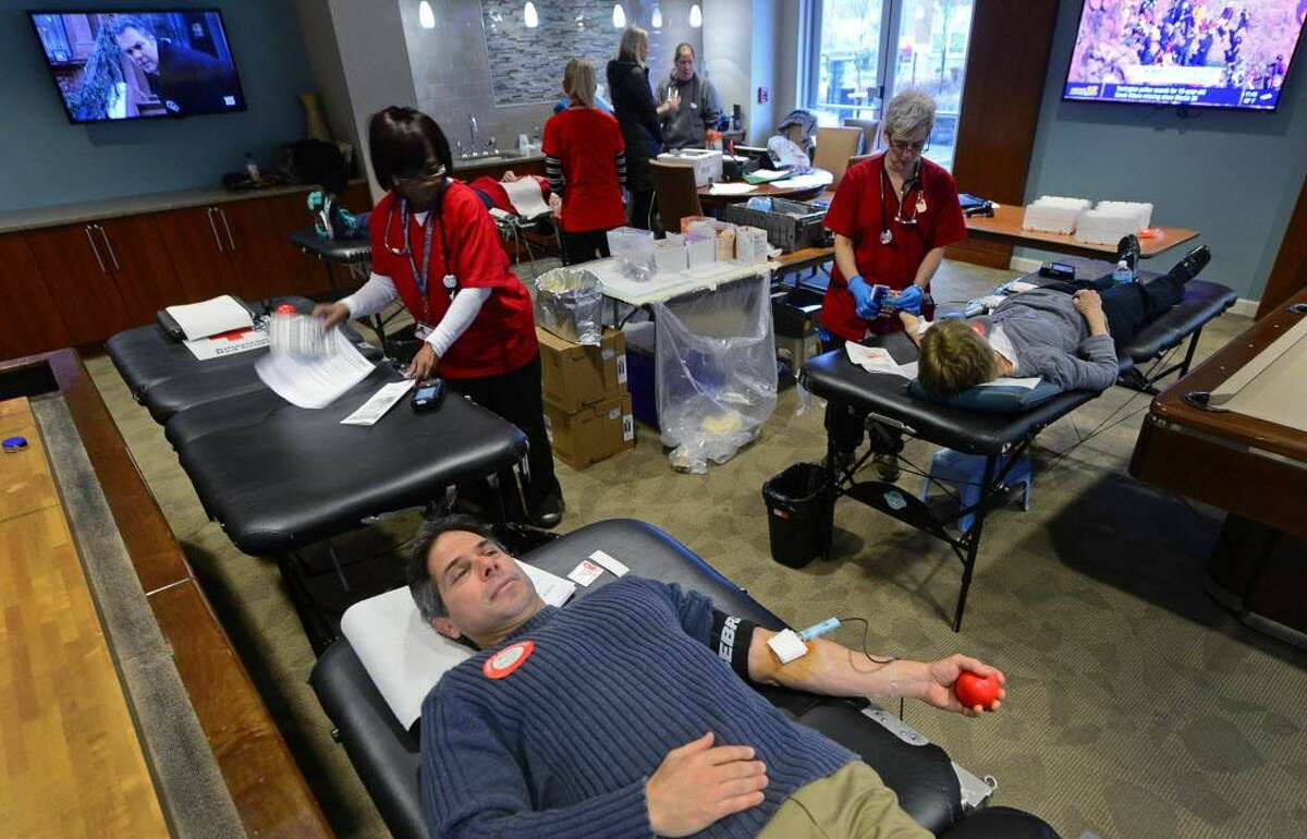 Weston resident Mark McCall gives blood during the American Red Cross Blood Drive Thursday, April 6, 2017, at Avalon Apartments, 8 Norden Place, in Norwalk, Conn. Local residents have been forced to seek out blood drives after the Westport Ave. Red Cross Donation Center in Norwalk closed last year. The next blood drive in Norwalk will be June 5th when the Red Cross Donation Bus will be parked in the Walgreen's parking lot on Westport Ave.
