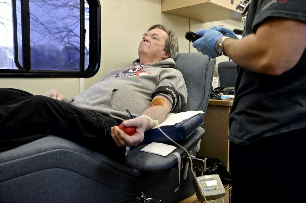 Patrick Patterson, of Sandy Hook, is attended to by Red Cross Phlebomist Chris Banziruk before he donates blood during the Red Cross Blood Drive at the Newtown Municipal Center on Wednesday afternoon, March 1, 2017. 3/2/2017, in Newtown, Conn. Upcoming blood drives : 3/2/2017 in Ridgefield, 1:30 p.m. - 6:30 p.m., at Ridgefield Park & Recreation Center, 195 Danbury Rd. In Bethel 3/3/2017: 1:30 p.m. - 6:30 p.m., at St. Mary's Church, 24 Dodging Town Road, in Danbury 3/10/2017: 1:30 p.m. - 6:30 p.m., at Central Christian Church, 71 West St. In Newtown on 3/7/2017: 1:30 p.m. - 6:30 p.m., at Newtown Congregational Church, 14 West St. 3/7/2017: at 8:30 a.m. - 1:30 p.m., Newtown Congregational Church, 14 West St.