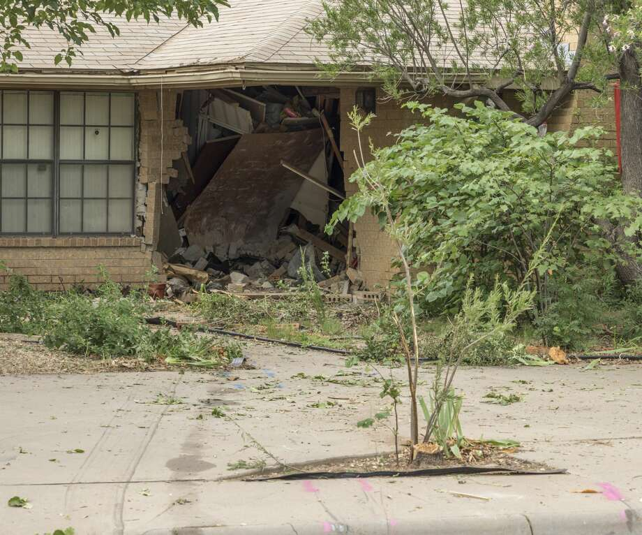 A large hole in the front of a home at 4515 La Salle Circle remains 7/06/17 morning following an accident overnight that resulted in one fatality. Tim Fischer/Reporter-Telegram Photo: Tim Fischer/Midland Reporter-Telegram