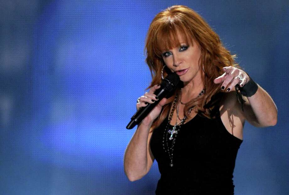 Reba McEntire headlines the annual Kickin for a Kure benefit on Friday. Photo: Kevin Winter /ST / 2010 Getty Images