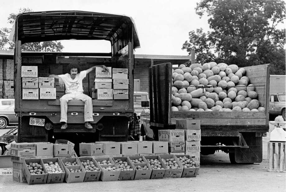 Rudy Marin sits in the truck he used to transport vegetables from his home in Mercedes, Texas, to markets on Airline in June 1979. Photo: Curtis McGee, HC Staff / Houston Chronicle