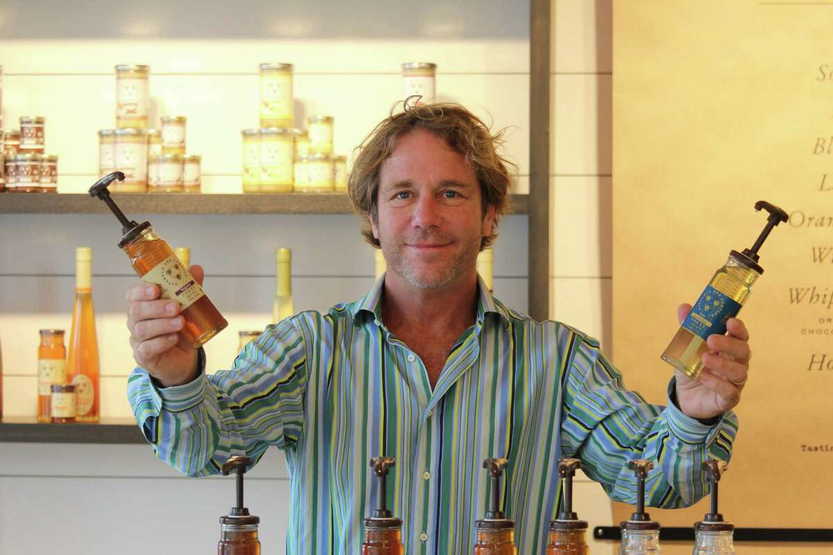 Ted Dennard, president and founder of Savannah Bee Company, poses at the honey bar of his store's new Bedford Square location on Church Lane.