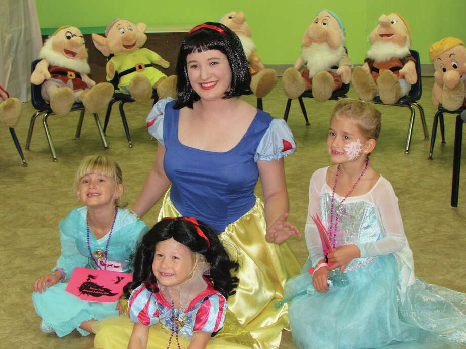 A student in costume as Snow White visits with youngsters during last year's Princess Party at the Edwardsville YMCA. This year's event will be conducted on Friday, Aug. 18. Photo: For The Intelligencer