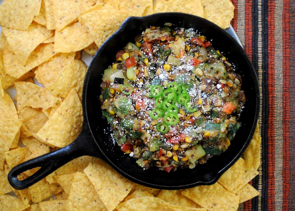 """Calabacita Frita Zucchini isn't always a page turner, but David Sterling's 2014 cookbook """"Yucatan: Recipes from a Culinary Expedition"""" helped change that for us. Our adaptation of his recipe makes a tasty side dish or party dip for a health-conscious crowd. Click here for recipe."""