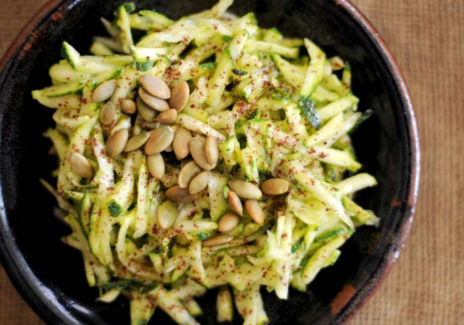 Seasoned with lemon and sumac, this zucchini salad is equal parts familiar and exotic. Photo: Paul Stephen /San Antonio Express-News / San Antonio Express-News