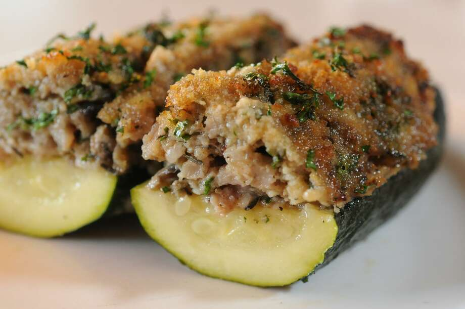 Sausage-stuffed zucchini, often billed as courgette farcie, is a French bistro favorite and easy to recreate at home. Photo: Paul Stephen / / San Antonio Express-News