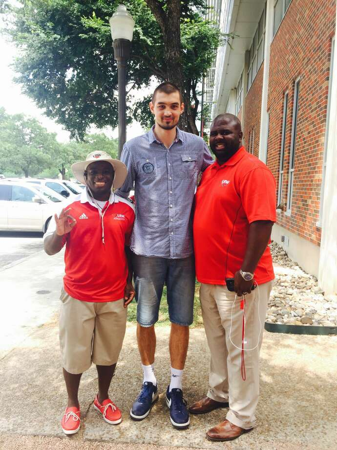 UIW center Konstantin Kulikov with assistant coaches John Smith (l) and Kenyon Spears. Photo: Courtesy University Of Incarnate Word