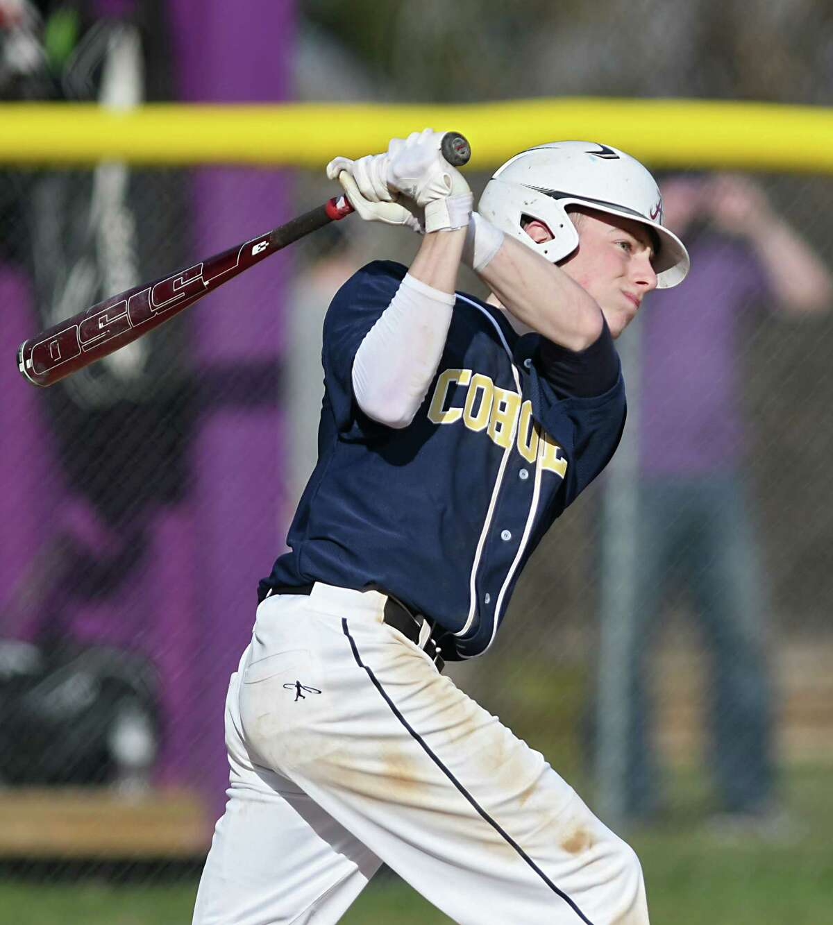 Cohoes shortstop Derek Becker watches his ball travel to the outfield during a baseball game against Voorheesville on Monday, April 10, 2017 in Voorheesville, N.Y. (Lori Van Buren / Times Union)