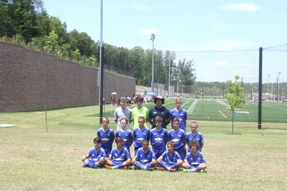 The CT Rush 2004 Regional Boys participated in the US Youth Soccer National Region I Championships in Stafford, Virginia this past weekend. The Rush boys, who are the CT state champions beat the state champions from West Virginia 4-0 and the state champions from Maryland 1-0 before losing to the state champions from New Jersey 1-0. New Jersey went on to win the entire tournament. Players include, bottom row, from left, Tyler Casey, Andrew Zizzadoro, Aiden Coelho, Jack Foster and Chase Hynes; middle row, from left, Steven Pickering, Liam Farrell, Evan Pinto, Ross Edkins, Lucas Vest and Patrick Osiecki, and top row, from left, Noah Pote, Jack Lynch, Coach Renato Topalli and Wes Kulikauskas. Missing from photo: Reid Petrie, Owen English and Jaiden Paniagua Photo: Contributed Photo / Hearst Connecticut Media / Norwalk Hour
