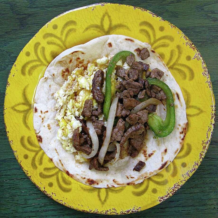 Fajita and egg taco on a handmade flour tortilla from El Patio Restaurant. Photo: Mike Sutter /San Antonio Express-News