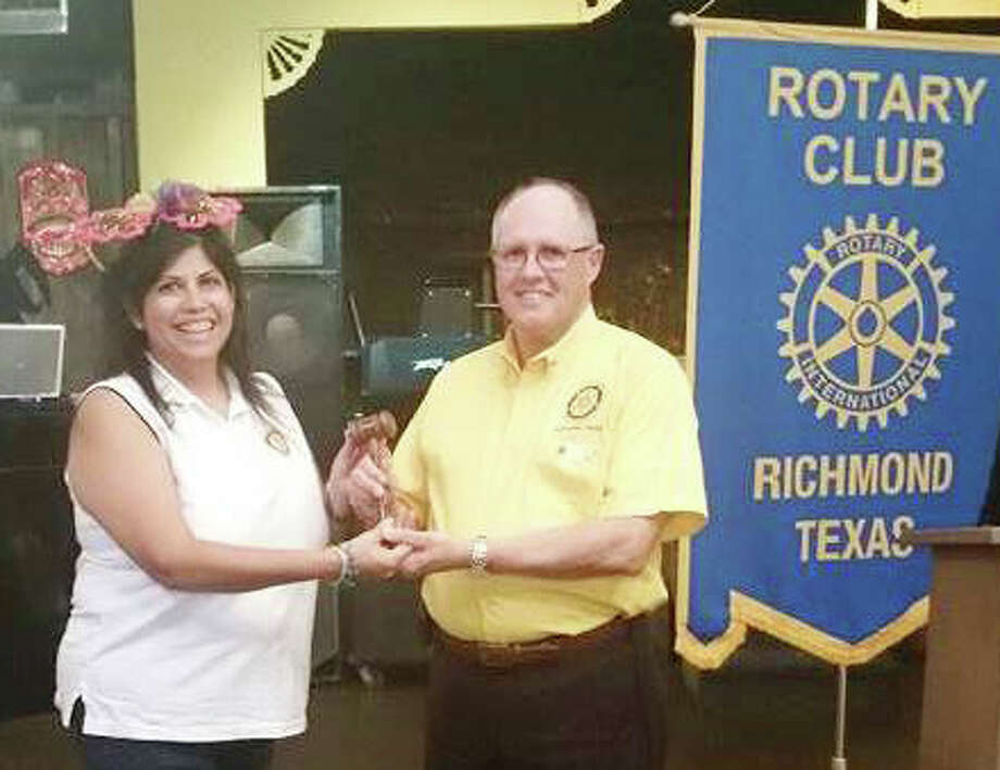 Passing leadership from past President Rosie Karlberg to incoming President Larry Pittman of the Rotary Club of Richmond. Photo: Rotary Club Of Richmond