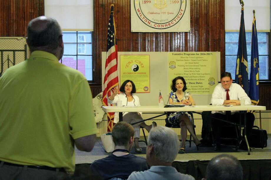 Wilton legislators — state Sen. Toni Boucher, state Rep. Gail Lavielle and state Rep. Tom O'Dea — answer questions from the public at last week's post-Session update at the Cannon Grange on Thursday, June 29, 2017. Photo: Stephanie Kim / Hearst Connecticut Media