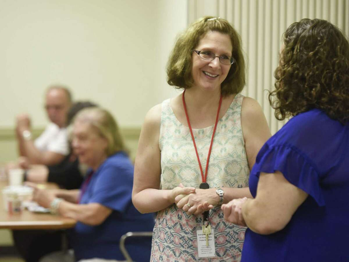 Incoming Superintendent of Schools Jill Gildea chats with teachers and school board employees during a welcome breakfast Thursday.