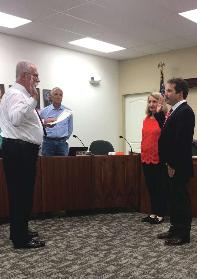 Dr. Chris Farrar (far right) was appointed as Edwardsville's new Ward 1 Alderman at Wednesday's City Council meeting. Photo: Cody King