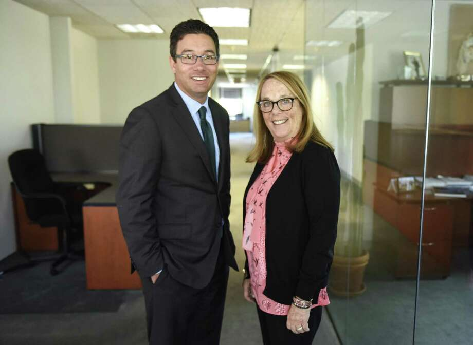 Eric J. Broder and Carole Topol Orland, of Broder & Orland Divorce & Family Law, pose at their new office in Greenwich, Conn. Wednesday, July 5, 2017. Broder & Orland, based in Westport, just opened a new full-sized office in Greenwich at 115 East Putnam Ave. Photo: Tyler Sizemore / Hearst Connecticut Media / Greenwich Time