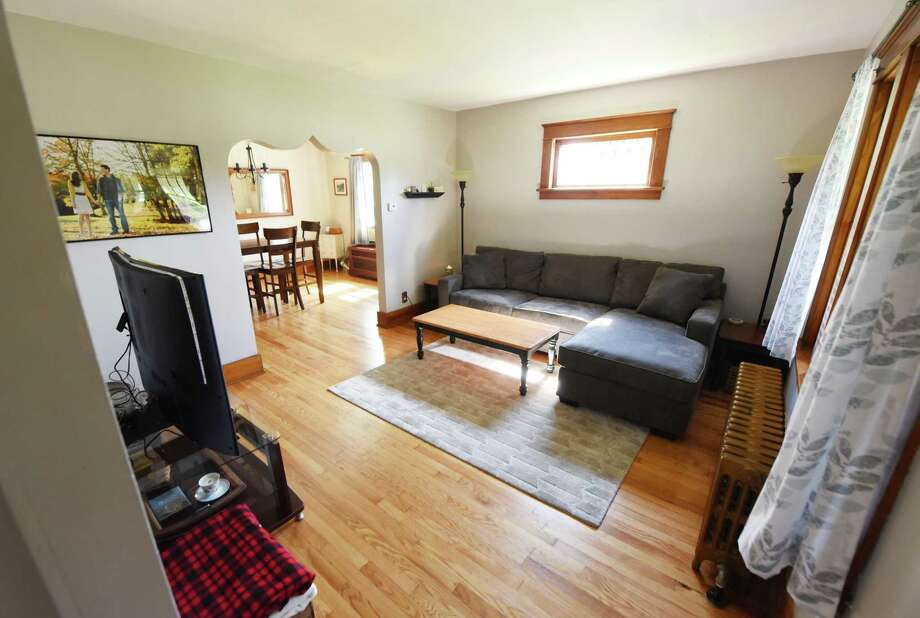 The living room in Will and Alison Beyer's home on Wednesday, June 28, 2017, in Colonie, N.Y. They used a renovation mortgage to pay for the purchase and renovation of their house. (Will Waldron/Times Union) Photo: Will Waldron / 20040860A