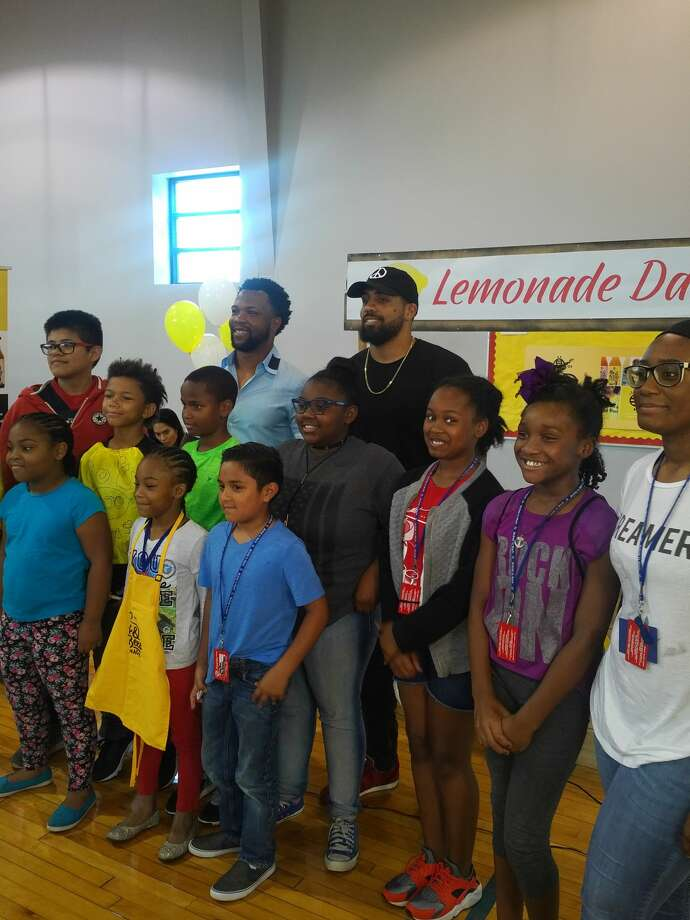 "Former Houston Texans Glover Quin and Arian Foster spoke to children at the ""Bee Brilliant Entrepreneur Day"" in Houston on Thursday, July 6, 2017. Photo: Aaron Wilson"
