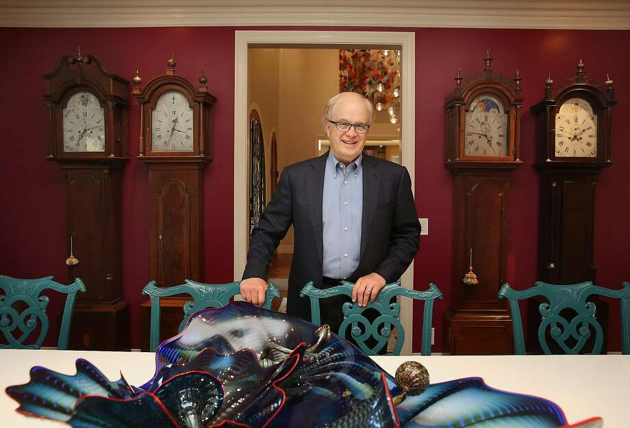 John Thompson, who helped hire leaders at Apple and Google, shows off his collection of grandfather clocks. Thompson is now leading the search for a new CEO to replace Travis Kalanick at Uber. Photo: Liz Hafalia, The Chronicle