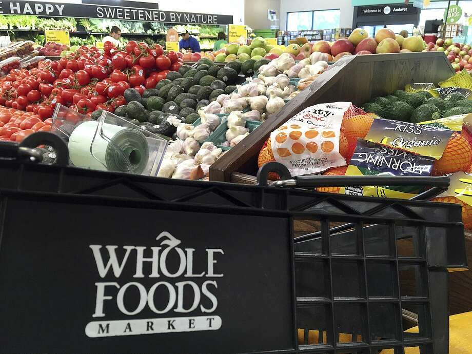 This June 5, 2017, photo, shows produce displayed at Whole Foods Market in Andover, Mass. The company announced it would reduce some plastic packaging and eliminate plastic straws in stores.  Photo: Elise Amendola, Associated Press