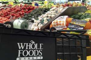 This June 5, 2017, photo, shows produce displayed at Whole Foods Market in Andover, Mass. Amazon is buying Whole Foods in a deal valued at about $13.7 billion. The two companies have not yet detailed how their proposed union might change the experience for customers. But the deal has the potential to boost the outsized ambitions of Amazon CEO Jeff Bezos and Whole Foods chief John Mackey, each of whom has already radically altered the way Americans shop. (AP Photo/Elise Amendola)