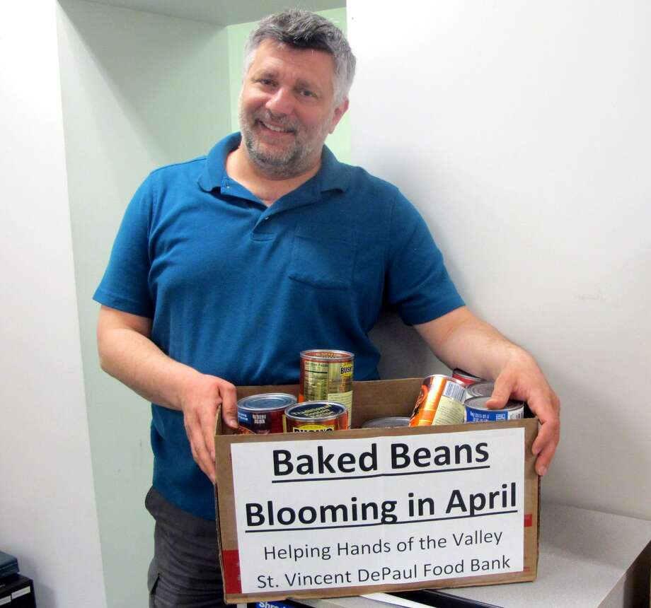 City/Town Clerk Marc Garofalo, a former four-term Derby mayor, stands near the collection box for Baked Beans in his office in Derby, Conn. This month city hall is seeking donations of tomato sauce for the St. Vincent de Paul food bank. Photo: Michael P. Mayko / Hearst Connecticut Media / Connecticut Post