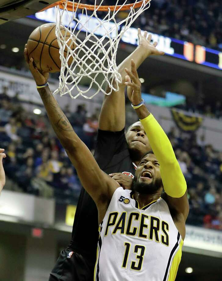 FILE - In this Dec. 30, 2016, file photo, Indiana Pacers' Paul George shoots against Chicago Bulls' Cristiano Felicio during the first half of an NBA basketball game, in Indianapolis. On Thursday, July 6, 2017, Pacers general manager and president of basketball operations Kevin Pritchard finally made the stunning blockbuster trade official by announcing the four-time All-Star was heading to Oklahoma City in exchange for Victor Oladipo and Domantas Sabonis. (AP Photo/Darron Cummings, File) Photo: Darron Cummings, STF / Copyright 2016 The Associated Press. All rights reserved.