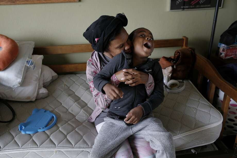Nichole Creer and her son, Demareau Davis, 5, in their new room in Teryl Burt's El Cerrito house. Creer was connected with Burt through the nonprofit Safe Time, which temporarily houses families in need with volunteers. Photo: Santiago Mejia, The Chronicle