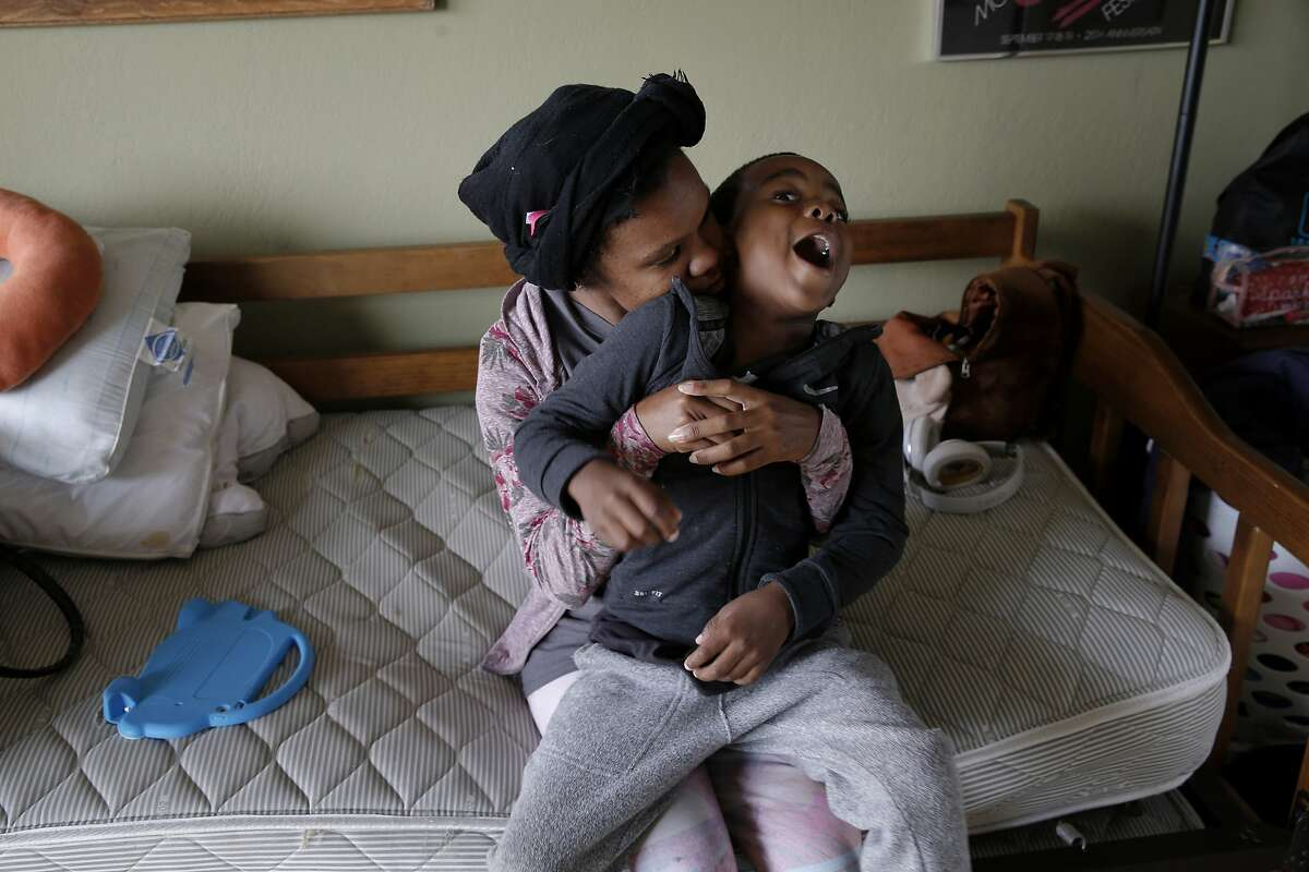 From left: Nichole Creer and her son Demareau Davis, 5, at their new room on Wednesday, June 28, 2017, in Oakland, Calif. Creer found a place to stay because of Safe Time, a new nonprofit that seeks to temporarily house families who are at-risk of homelessness in the homes of volunteer hosts. Teryl Burt is Creer's volunteer host.