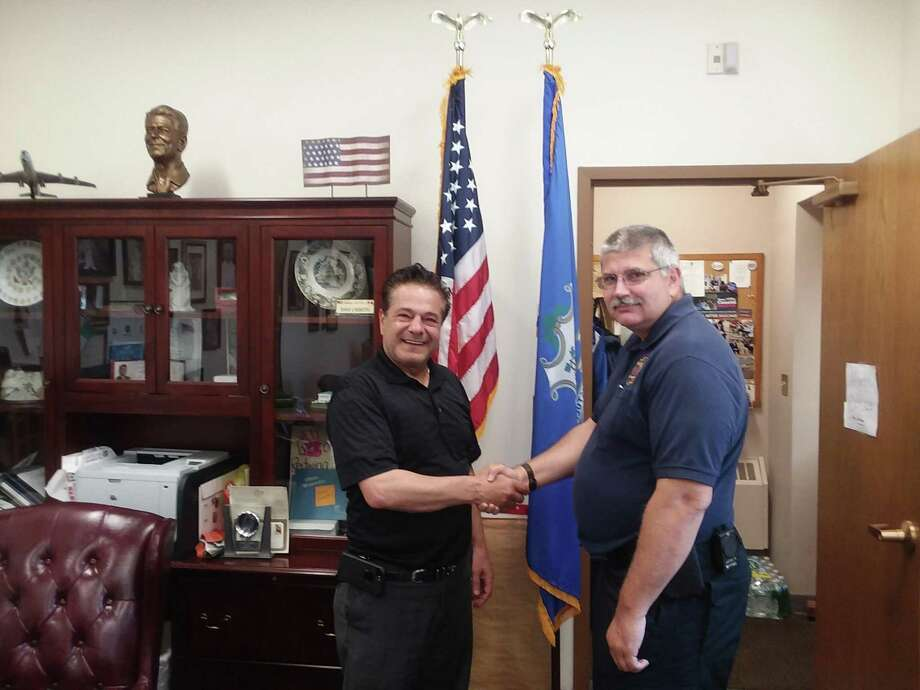 Ansonia Mayor David Cassetti congratulates Darrick Lundeen after promoting him to the city's fire marshal. Lundeen had been serving as acting fire marshal since the retirement of Ray Tingley in February. Photo: / Contributed Photo
