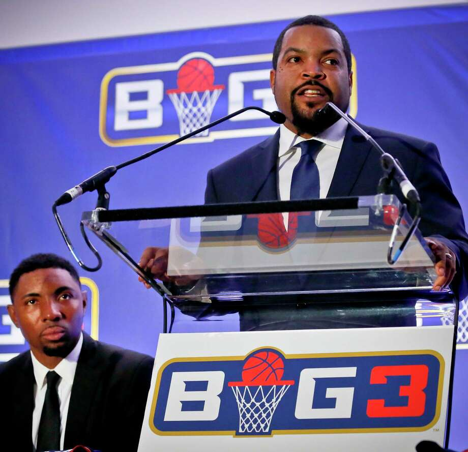 FILE - In this Jan. 11, 2017, file photo, entertainer Ice Cube, right, announces the launch of the Big3 professional basketball league as former NBA player and players union deputy Roger Mason, left, looks on, in New York. Ice Cube says his Big3 basketball league is open to moving its championship game to another arena in Las Vegas to make way for Floyd Mayweather's boxing match against Conor McGregor. The game is scheduled for Aug. 26 at T-Mobile Arena, the biggest venue in Las Vegas. Mayweather's fight against McGregor was later announced for the same site. (AP Photo/Bebeto Matthews) Photo: Bebeto Matthews, STF / Copyright 2017 The Associated Press. All rights reserved.