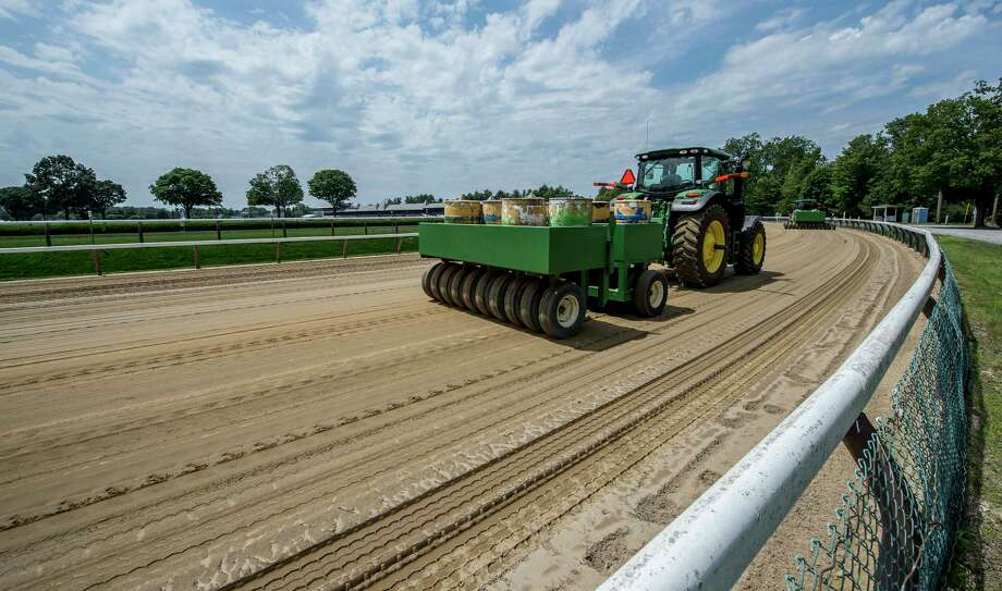 The surface of the Saratoga Race Course is prepared for coming rains on Thursday, July 6, 2017, in Saratoga Springs, N.Y.  (Skip Dickstein/Times Union) Photo: SKIP DICKSTEIN, Albany Times Union