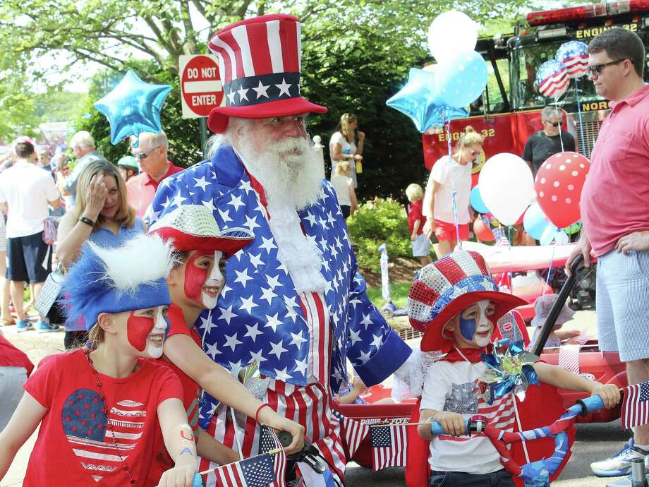 The Austen siblings — Keira, Olivia and Spencer — won most patriotic family and got to lead the 13th Annual 4th of July Push-N-Pull Parade in Darien, Conn on July 4, 2017. Photo: Erin Kayata / Hearst Connecticut Media / Darien News