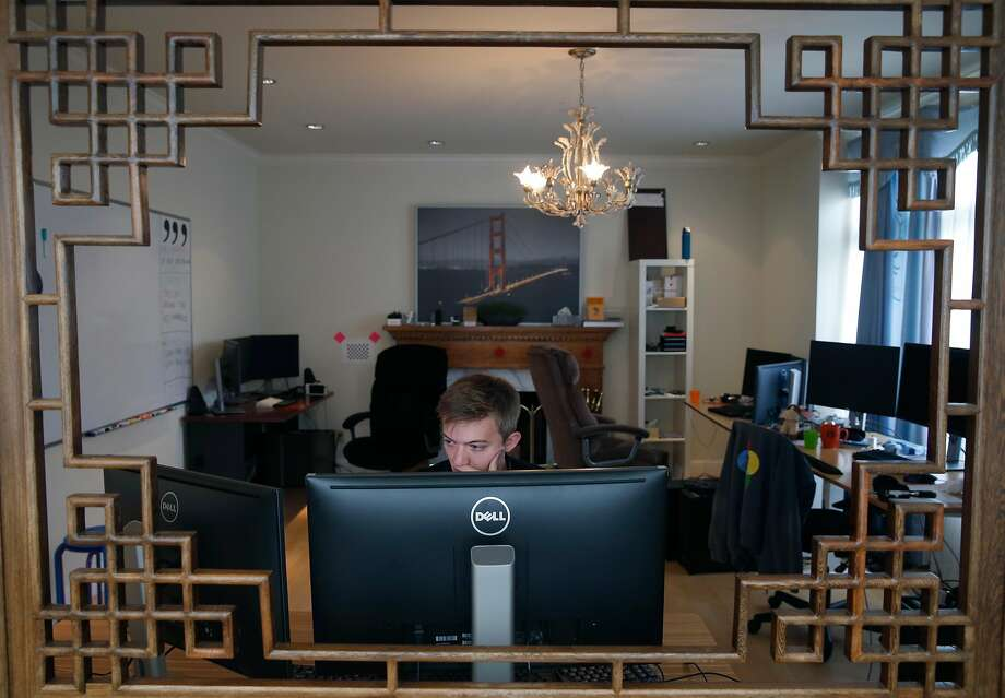 Eli Riggs works in the upstairs office, a converted living room, at Comma.ai's headquarters. The company is releasing various components that developers and tinkerers can use to create their own kits to add features like lane-keeping assistance and adaptive cruise control to existing cars. Photo: Paul Chinn, The Chronicle
