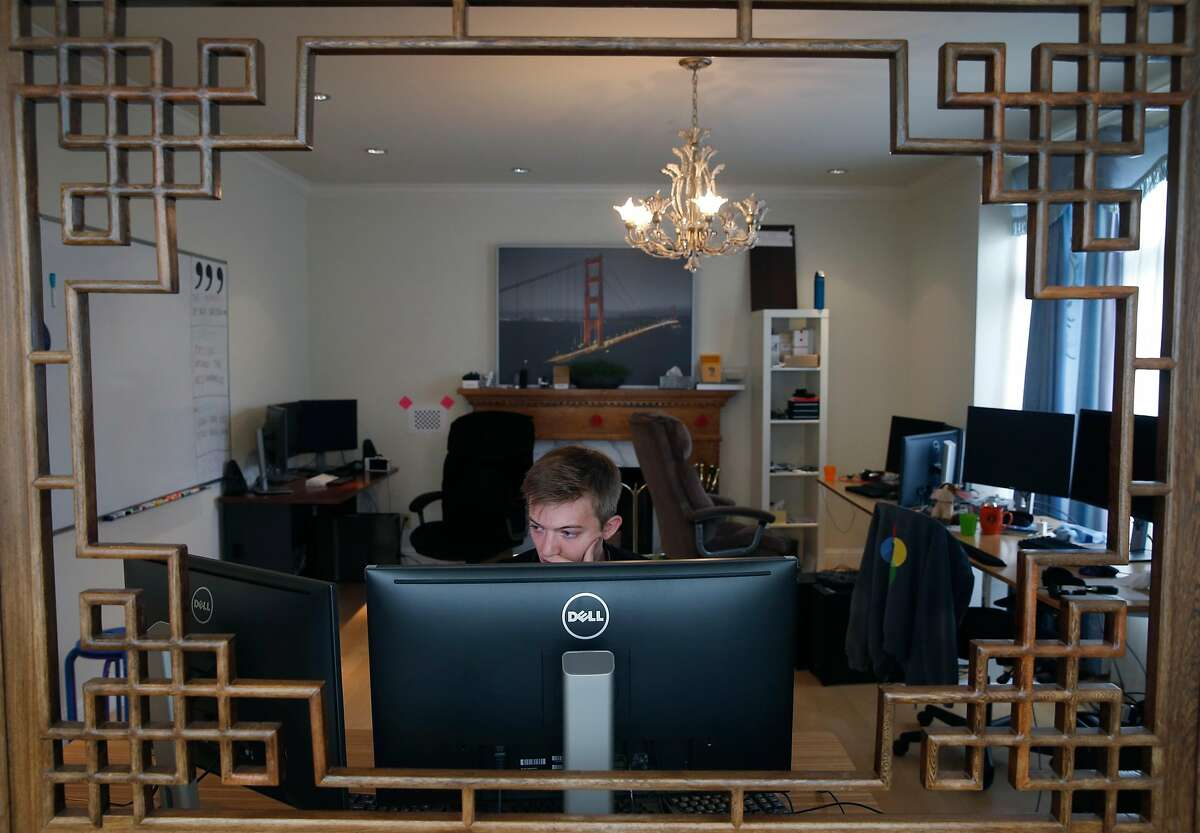 Eli Riggs works in the upstairs office, a converted living room, at comma.ai headquarters in San Francisco, Calif. on Thursday, July 6, 2017. The self driving car start-up company operates out of a five-bedroom home in the St. Francis Wood neighborhood.