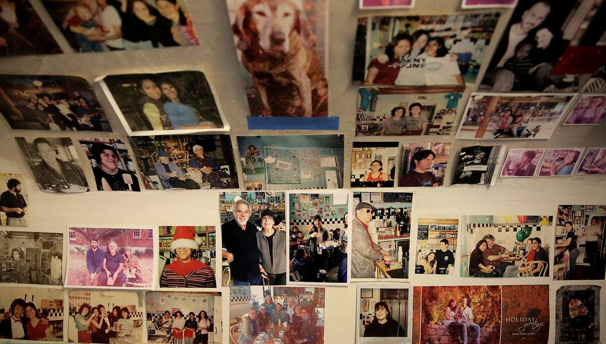 Thirty-five years worth of memories line the walls of the bathroom Toy Boat Dessert Cafe in the Inner Richmond on Thursday, July 6, 2017. Jesse Fink and his wife, Roberta, have run the cafe for 35 years.
