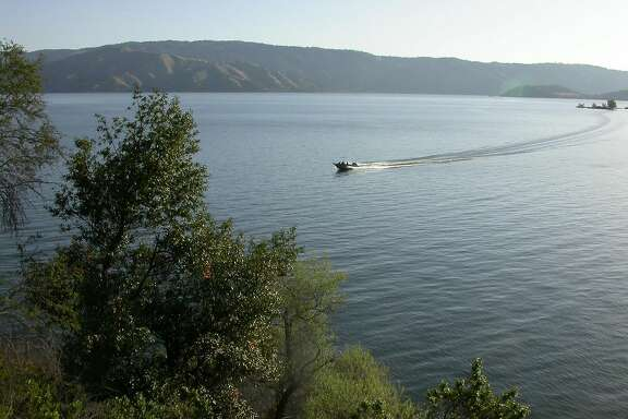 A boat on Clear Lake leaves a curving arc of a wake as it cruises north of Clear Lake State Park on the western shore of the lake.