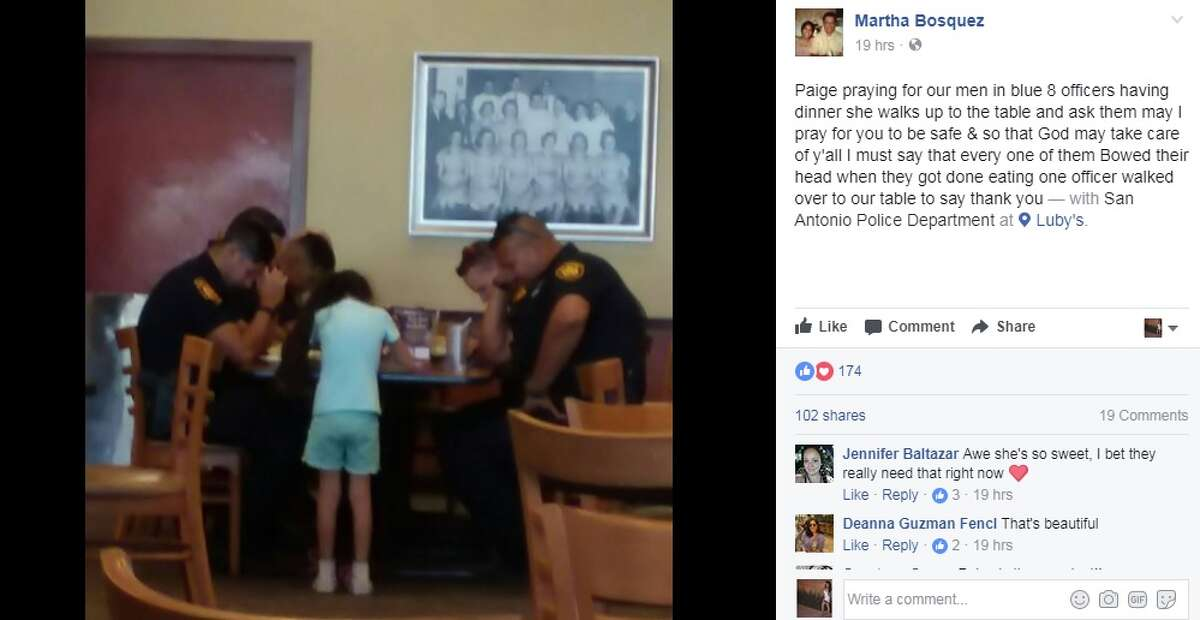 """""""Paige praying for our men in blue 8 officers having dinner she walks up to the table and ask them may I pray for you to be safe & so that God may take care of y'all I must say that every one of them Bowed their head when they got done eating one officer walked over to our table to say thank you, """" Martha Bosquez wrote on Facebook."""