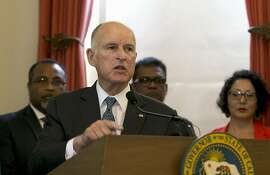 FILE - In this June 13, 2017, file photo, California Gov. Jerry Brown discusses climate change at a news conference in Sacramento, Calif. Gov. Brown plans to convene a Global Climate Action Summit next year in his latest action to position the state as a leader in battling global warming as the White House recedes. (AP Photo/Rich Pedroncelli, File)