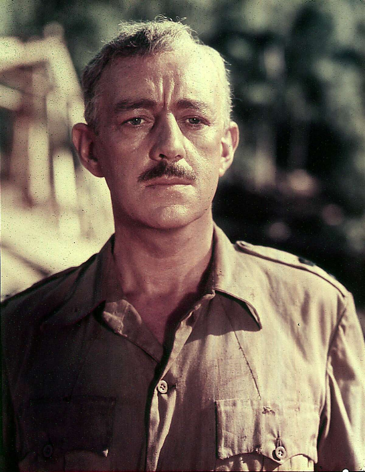 """FILE--This is a 1957 file photo of British actor, Sir Alec Guinness in British uniform during the filming of """"The Bridge on the River Kwai."""" Guinness, whose roles in a 66-year career ranged from Hamlet to Obi-Wan Kenobi in """"Star Wars,"""" has died at age 86, a hospital spokesman said Monday, August 7, 2000. Guinness became ill at his home near Petersfield, southern England and was taken by ambulance to the King Edward VII Hospital where he died Saturday, August 5, 2000, said hospital spokeswoman Jenny Masding. The cause of death was not released. (AP Photo)"""